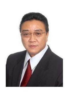 Kevin Lau of CENTURY 21 Lewis Real Estate