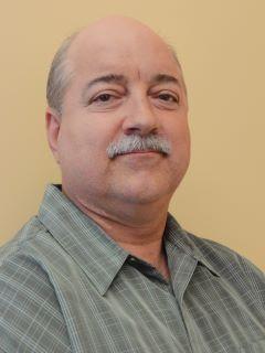 Raymond Dore of CENTURY 21 Action Realty