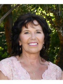 Debra Bibeau from CENTURY 21 Tropical Breeze Realty