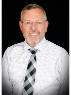 Bruce Holmes from CENTURY 21 Venture Ltd.