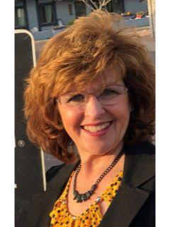Lori Carpenter from CENTURY 21 Desert Estates Realty