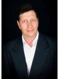 Michael Lee from CENTURY 21 Venture Ltd.
