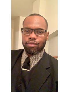 Chris Awambu from CENTURY 21 Top Realty