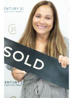 Gwen Michon of CENTURY 21 Investment Realty