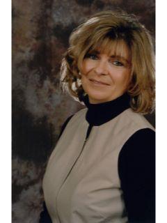 Peggy Laud of CENTURY 21 Cornelis-Simpson, Inc.