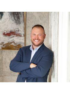 Travis Oltman of CENTURY 21 Midlands