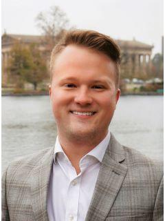 Brandon Carver of CENTURY 21 West Main Realty & Auction