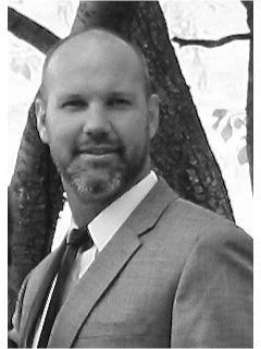 Christian Redd of CENTURY 21 N&N, Realtors