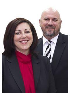 Jay & Christina Weaver of CENTURY 21 Alton Clark