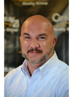 Justin Phillips of CENTURY 21 Realty Group, LLC
