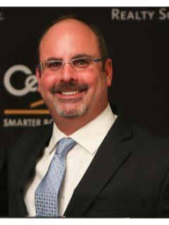 Larry Burke of CENTURY 21 Realty Solutions