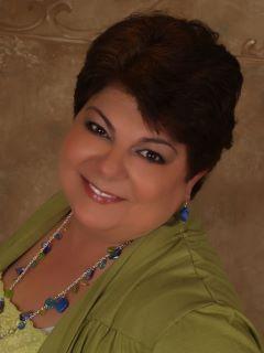 Yolanda Burgan of CENTURY 21 Mack-Morris Iris Lurie Inc