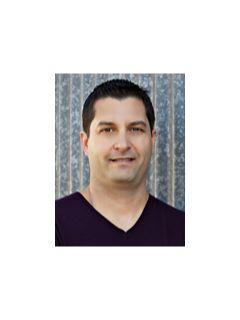 Carlos Espinola of CENTURY 21 M&M and Associates