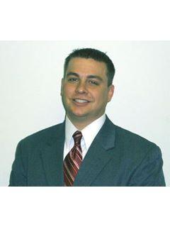 Justin Ackerman of CENTURY 21 Thomas Realty