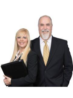 Real Estate by John & Tennille of CENTURY 21 Amber Realty Inc.
