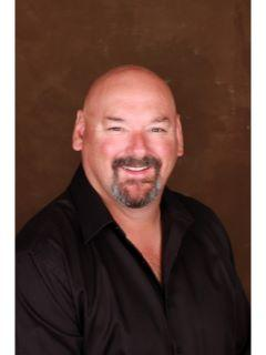 Rolly Phillips of CENTURY 21 Price Right photo